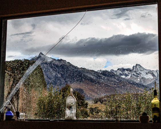 """Rainy Season""-Shot thru the cracked window of the Hof's common area. Afternoon showers arrive again"